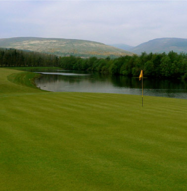 Carrick Golf Course, photograph of a green with hills in the background. CC-BY-SA/2.0 - © George Rankin - geograph.org.uk/photo/422974