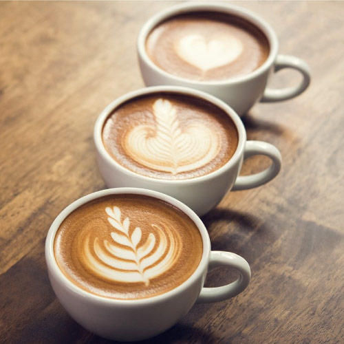 3 Cups of Coffee with designs in the milk froth on top of them. Image Source: https://pixabay.com/photos/coffee-cup-caffeine-espresso-4618705/