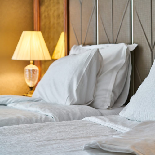 Hotel Room. Image Source: https://pixabay.com/photos/hotel-room-bed-pillow-sheets-4373088/