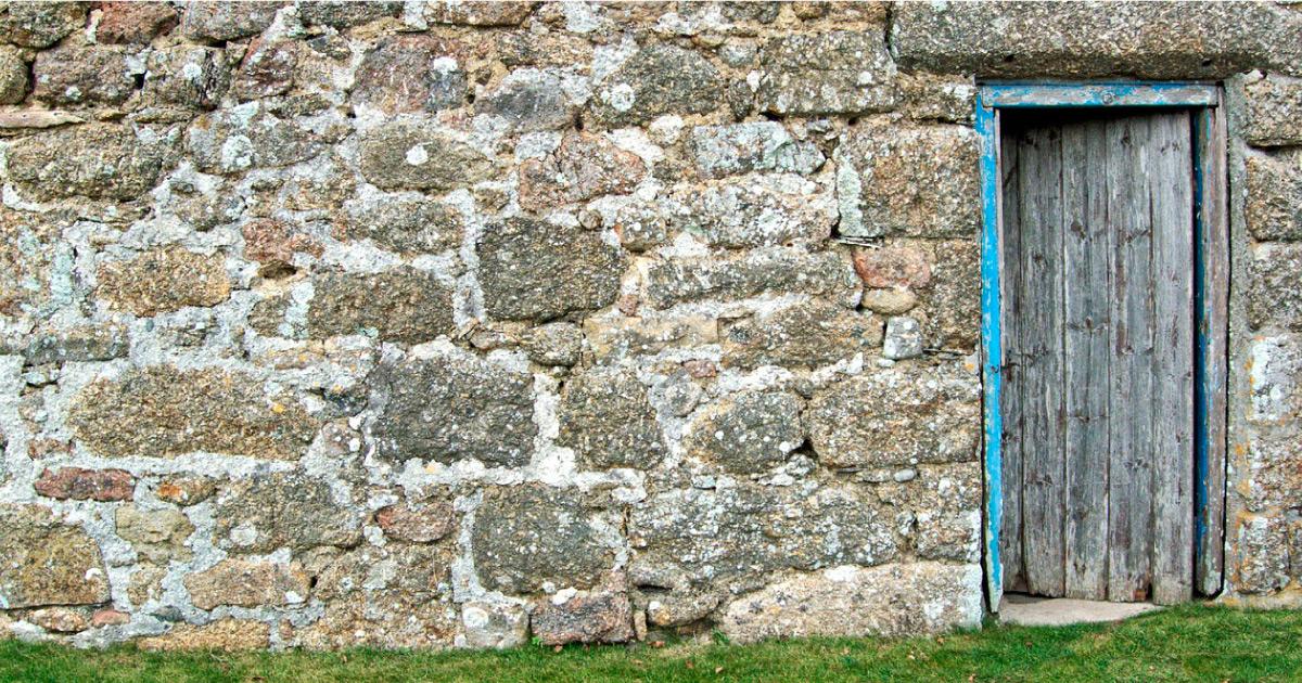 Door in stone wall. Image source: https://pixabay.com/photos/door-wall-old-stone-granite-1457752/