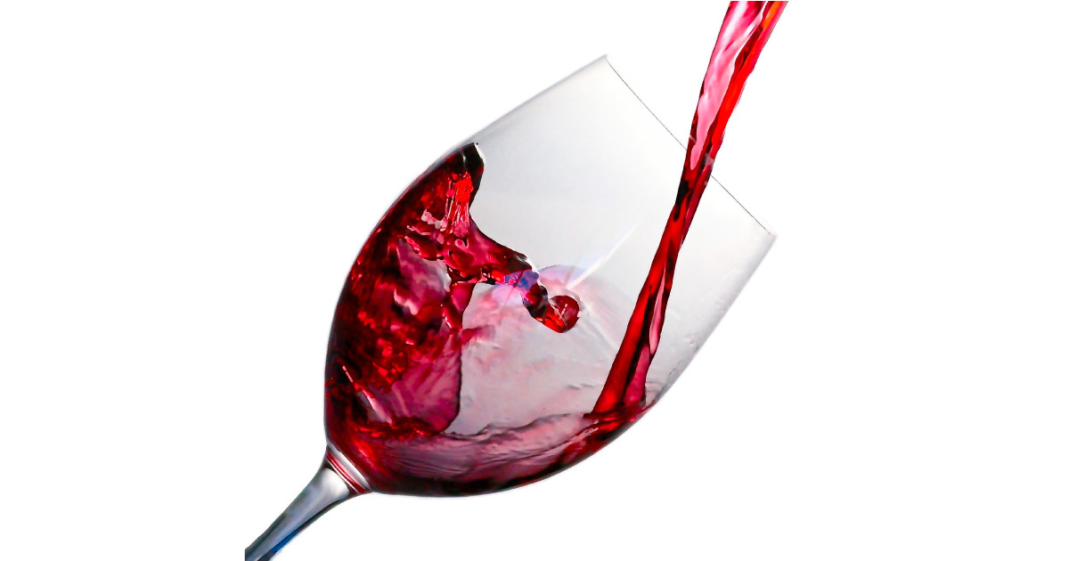 Glass of red wine being poured. Image source: https://pixabay.com/photos/wine-splash-glass-red-alcohol-1543170/
