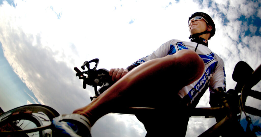 Photo of road cyclist, taken looking up against the sky. Image souce: https://pixabay.com/photos/cycling-cyclist-bicycle-rider-664753/