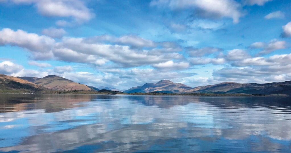 Reflection of Ben Lomond in Loch Lomond. Image Source: https://pixabay.com/photos/loch-lomond-ben-lomond-reflection-3028169/