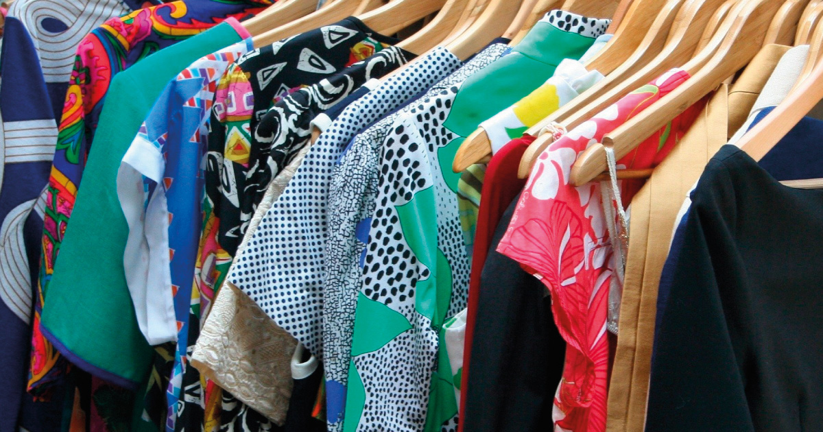 Rack of Clothing. image source https://pixabay.com/photos/dresses-apparel-clothing-clothes-53319/