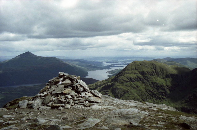 Summit cairn on Ben Vane. Ben Lomond, Loch Lomond and A'Chrois beyond. © Russel Wills, CC BY-SA 2.0 Image source: https://www.geograph.org.uk/photo/1628312